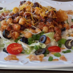 Taco Bean Salad Recipe - This filling taco bean salad uses four types of beans, ground beef, and a homemade dressing.