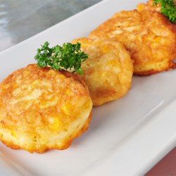 Fresh Sweet Corn Fritters Recipe - Celebrate the arrival of fresh sweet corn by making a batch of light and delicate corn fritters. Serve drizzled with cane syrup or maple syrup for a breakfast treat or as a side dish with ham or ribs.