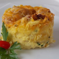 Cheddar Pudding Recipe - This Cheddar cheese bread pudding is delicious served either hot or cold with a salad.