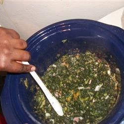Slow Cooker Collard Greens Recipe - Got this from a coworker who made these for the office holiday potluck. Collard greens are cooked all day with ham shanks and pickled jalapeno. Yum!