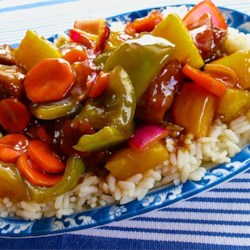 Sweet and Sour Pork Recipe - Pork is stir-fried with peppers, carrots, onions and pineapple in this version of the classic dish. Easy to make, and delicious.