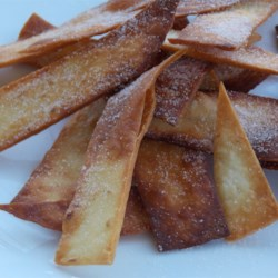 Fried Cinnamon Strips Recipe - Flour tortilla strips are deep-fried then coated with cinnamon and sugar for a quick, crunchy snack.