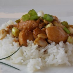 Thai Chicken with Cashew Nuts Recipe - Fish sauce and sesame oil give this dish a distinctive flavor, and hot green chile peppers ensure it will be spicy. This simple dish takes only minutes to prepare.