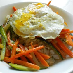 Vegetarian Bibimbap Recipe - A vegetarian version of the Korean one-bowl meal of rice and vegetables topped with an egg is ready in less than an hour.