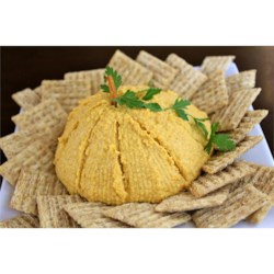 "Pumpkin Cheese Ball Recipe - Shredded cheddar cheese, cream cheese, and pumpkin are mixed with pineapple preserves and spices in this sweet and tangy cheese ball. Add a pretzel rod ""stem"" to make it look like a pumpkin!"