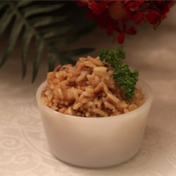 Really Simple Rice Recipe - Replacing water with low-sodium chicken broth gives this rice side dish with onion and garlic salt a more savory flavor.