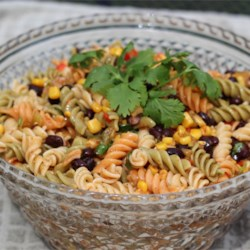 Mexicali Pasta Salad Recipe - Tri-colored rotini pasta is tossed with corn, black beans, Mexican cheese, and red bell peppers for a colorful and tasty pasta salad perfect for picnics.