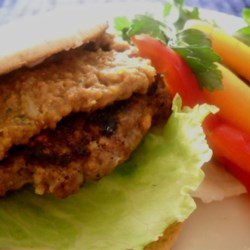 Thai Burgers Recipe - What a wonderful taste surprise. Ground beef is mixed with lemon grass, chili paste, shallots and peanuts, and then formed into thick patties, and grilled. Just before serving they 're sprinkled with fresh lime juice. Makes four generous servings.