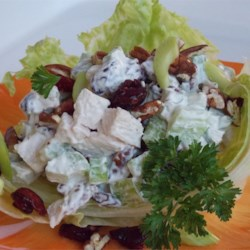 Cape Cod Turkey Salad Recipe - Leftover turkey has a delicious new personality in this tasty salad inspired by New England cranberries and fresh herbs such as parsley and rosemary. Serve the salad on croissants, crusty rolls, or a bed of lettuce. A lighter version can be made using reduced fat mayonnaise and sour cream.