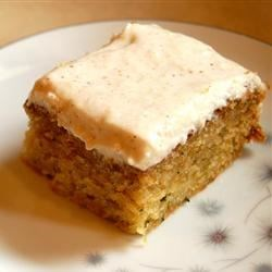 Zucchini Cake with Cream Cheese Applesauce Icing Recipe - A zucchini sheet cake has an easy and different frosting made with cinnamon-flavored applesauce and cream cheese.