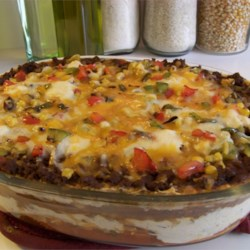 Mexican Lasagna Recipe - My whole family loves this beefy lasagna flavored with taco seasoning. Even my picky five-year-old will eat it. Serve with shredded lettuce, fresh sliced tomatoes, olives and sour cream.