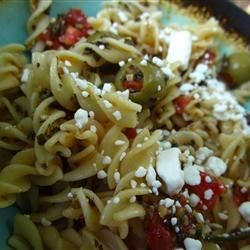 Fire and Ice Pasta Recipe - When feta cheese finishes a dish, we usually love it. This amazing pasta is no exception. The sauce is great, made from sun dried tomatoes, garlic, chives, tomatoes, olives, basil and garlic.