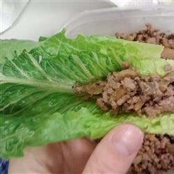 Turkey Lettuce Wraps with Shiitake Mushrooms Recipe - Lean ground turkey, rich shiitake mushrooms, and lots of crunchy water chestnuts come together quickly in a tasty filling for lettuce leaf wrappers.