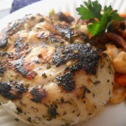 Grilled Chicken and Herbs Recipe - Chicken breasts flavored with herbs and garlic are grilled to perfection for an easy, light, and quick main dish the family will love.