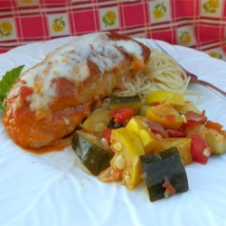Zesty Zucchini and Squash  Recipe - Yellow squash and zucchini are simmered with onion, tomatoes and green chile peppers.