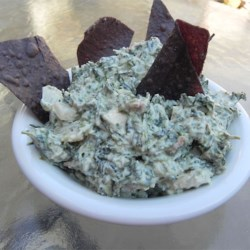 Healthier Best Spinach Dip Ever Recipe - A favorite dip made healthier by using reduced-fat mayonnaise and sour cream, served in a whole wheat bread bowl.  So tasty, you'll come back for more!