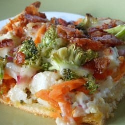 Veggie Squares Recipe - These are really good. Bake the crescent rolls and spread each one with cream cheese and mayonnaise. Sprinkle with dill and garlic, and arrange assorted veggies on top. Chill and cut into squares for appetizers.