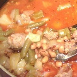 Black-Eyed Pea Bratwurst Stew Recipe - Hot wing sauce gives this sausage and black-eyed pea stew a spicy kick.