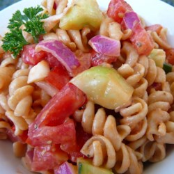 Veggie Pasta Salad Recipe - Fresh hot chile pepper gives a little heat to this pasta salad packed with sweet onion, bell pepper, tomatoes, and cucumber.