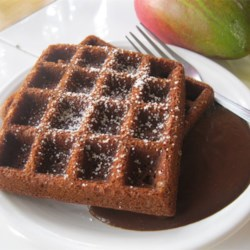 Gingerbread Waffles with Hot Chocolate Sauce Recipe - Yummy and delicious. These extraordinary waffles are flavored with molasses and spices. Topped with homemade chocolate sauce, they are perfect for a special breakfast treat.