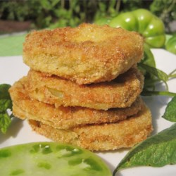Best Fried Green Tomatoes Recipe and Video - Serve these tomatoes outside with a glass of iced tea one summer night and enjoy the sunset with someone you love.