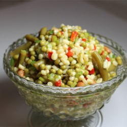 Marinated Salad Recipe - A warm lovely vinaigrette dressing, with just a bit of sugar, is poured over a bowl of fresh and canned veggies and popped into the fridge. Twenty-four hours you have green bean-corn-celery-pea-corn-pimento-delight.