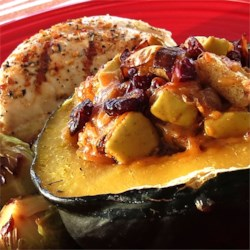 Apple-Stuffed Acorn Squash Recipe - Granny Smith apples and Cheddar cheese fill these tender acorn squash halves.