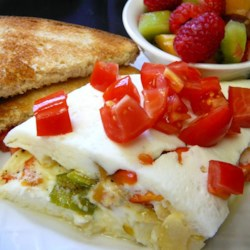 Easy Egg White Omelet Recipe - A carton of refrigerated egg whites plus some onion, green pepper, and mushrooms makes a fast, protein-packed breakfast that you can cook in the microwave.