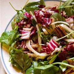 Fennel and Watercress Salad Recipe - A fabulously different salad that serves twenty and is beautiful in a bowl. Lots of color and taste sensations. Radicchio, fennel, watercress, and pecans are tossed with a lovely balsamic vinaigrette studded with bits of dried cranberries.