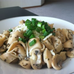 Portobello Bellybuttons Recipe - Mushrooms and tortellini are tossed in a butter, wine and garlic sauce for a quick and delicious pasta dish.