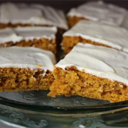 Paul's Pumpkin Bars Recipe - A homemade pumpkin sheet cake topped with cream cheese icing that will feed a crowd. Everybody loves them!