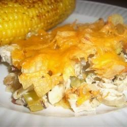 Hot Chicken Salad Casserole Recipe - This version features water chestnuts, mushrooms and Cheddar along with the celery and almonds, and is garnished with crushed potato chips.