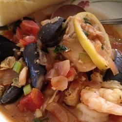 Chef John's Cioppino Recipe - This version of San Francisco's famous Cioppino has it all: the tangy, spicy broth featuring shrimp, mussels, cod, and Dungeness crab.