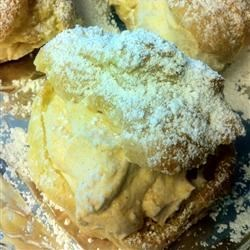 Pumpkin Cream Puffs Recipe - The perfect ending to a fall dinner, these classic cream puffs get a golden, sweet and creamy pumpkin filling.