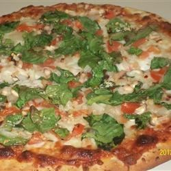 Red, White, and Green Pizza Recipe - Spinach, white cheeses, and tomatoes stack up on pizza dough to make a pizza in the spirit of the Italian flag.