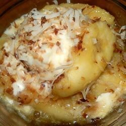 Brazilian Bananas Recipe - Bananas are baked in a citrus sauce then topped with coconut before serving in this tropical treat.