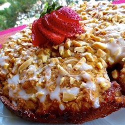 Delicious Strawberry Almond Coffee Cake - A Guilt Free Indulgence! Recipe - Brown sugar-coated strawberries are baked into a vanilla-laced coffee cake batter and topped with almonds. Serve for breakfast, brunch, or dessert!