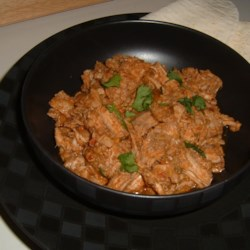 Mexican Style Shredded Pork Recipe - This is an amazing shredded pork recipe. It is easy to prepare and simmers in a slow cooker all day, ready to enjoy when you arrive home. I serve it over rice (laced with lime juice and fresh cilantro), Cheddar cheese, salsa, guacamole, and a dollop of sour cream. Amazing!