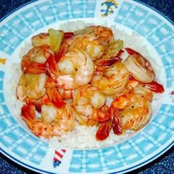 Honey Ginger Shrimp Recipe - This quick and easy, sweet and spicy dish combines honey, ginger, shrimp and garlic, and can be served over steamed vegetables or pasta.