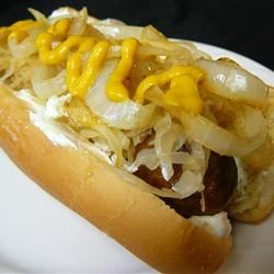 Seattle Cream Cheese Dogs Recipe - On the streets of Seattle, after the bars close, and during sporting events, these are a local favorite--warm cream cheese spread on your favorite hotdog!