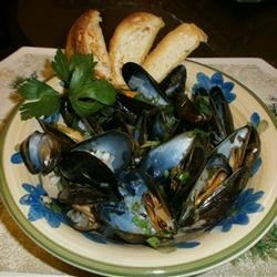 Mussels Mariniere Recipe - This is a simple recipe.  Most of the work is preparing the mussels; cooking takes very little time.  When you have finished eating the mussels, dip bread in the buttery wine sauce.