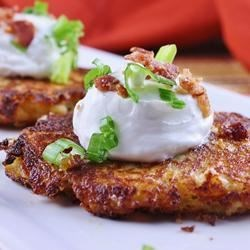 Loaded Mashed Potato Cakes Recipe - Cheesy, pan-fried patties of mashed potatoes are sure to be the star of your next meal.