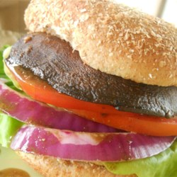 Savory Portobello Mushroom Burgers  Recipe - Just brush large, thick portobello mushroom caps with an easy and flavorful dressing made with olive oil, balsamic vinegar, Dijon mustard, and garlic, and grill a few minutes until juicy and tender.