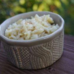 Orzo and Rice Recipe - Tiny ovals of orzo pasta, toasted golden brown in butter, is cooked in bouillon with long-grain rice to make an easy and versatile side dish. Try tossing with chopped parsley and a grating of Parmesan cheese before serving.