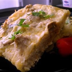 English Muffin Breakfast Strata Recipe - Green chilies and English muffins give this breakfast strata a spicy and new twist on the traditional recipe. Assemble the night before and just bake in the morning for a perfect brunch!