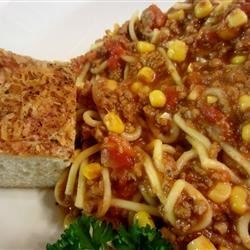 Dad's Spaghetti Soup Recipe - This is a sumptuous, very robust tomato soup. Sauteed onions and garlic give a flavorful base and ground beef adds richness. A bit of corn finishes it with a fresh sweetness.