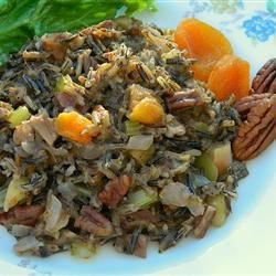 Minnesota Real Wild Rice Stuffing Recipe - The nutty flavor of wild rice blended with dried apricots, pine nuts, and pecans makes a hearty side dish for the holiday table.