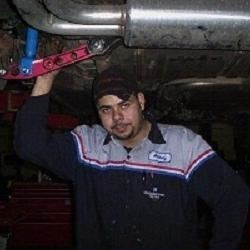 Me at my old shop working on my old car