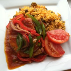 Tomato Chops II Recipe - This is pork chops with onions and peppers smothered in tomato sauce.