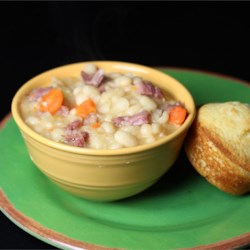 Basic Ham and Bean Soup Recipe - This recipe for a hearty ham white bean soup calls for carrots, celery, onion, bay leaves and mustard powder.